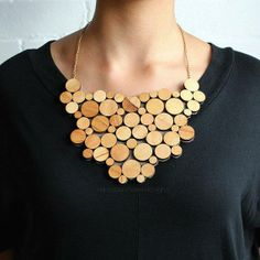 Obsessed with both circles and wood art. Better with a deep v-maybe sexy black dress and tan heels...
