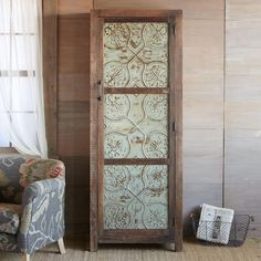 MARIETTA PRESSED TIN CABINET -- Lovingly crafted from reclaimed wood and pressed tin with plenty of storage and plenty of panache that suits any ambience. The wood is weathered and distressed with a waxed finish