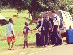 Missionaries on their first day in Sierra Leone greet local kids.