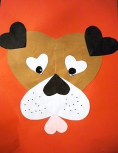 For this project, I had all of the hearts pre-cut for the students except for the 2 largest (brown and white). First, students chose what color background they wanted. Then they created the brown and white hearts by folding the paper in half, drawing a half heart (hand over hand), and cutting them out. Once the 2 largest hearts were glued on the background, they began gluing down all of the other hearts. We used dot markers for the eyes (I gave them several color options), and added freckles