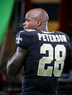 Adrian Peterson black and gold looks good on him!!!