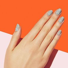 Subtle arcs add the perfect minimal touch to our updated moon mani, Ringleader. Try it in classic color combinations like dove gray and white. #paintboxmani