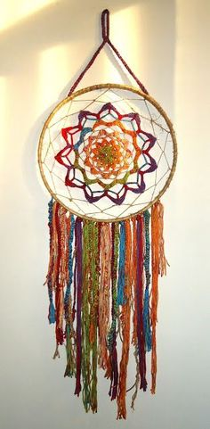 Inspiration :: Colorful dream catcher, a crocheter's free-form interpretation. Embroidery hoop wrapped with jute twine to cover, plenty of colorful yarn scraps. Dreamcatchers, Crochet Baby Pants, Beautiful Dream Catchers, Crochet Dreamcatcher, Art Du Fil, Hoop Dreams, Jute Twine, Crochet Patterns For Beginners, Crochet Home