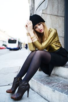 Legs in nylon: metallic gold top, black skirt and hose with high heel ankle boots