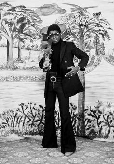 Untitled, 1973 by Hamidou Maiga. Born 1932, Bobodioulasso, Burkina Faso. // Maiga constructed each image using a mixture of carefully chosen props, costume and painted backgrounds, giving them a new graphic intensity with black and white film. #contemporary #africa #photography