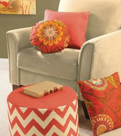 Dress up a living room with a  ottoman and coordinating pillows!