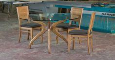 שולחן אוכל עגול - שילוב של זכוכית ורגלי עץ מעוצבות ניתן להזמין בקוטר 110-160 ס