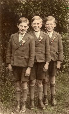 Found image. Three lads in school uniform photographed in the 1930s. I do not know what the buttonholes signify. I imagine these boys to be brothers snd perhaps the two on the right are twins.