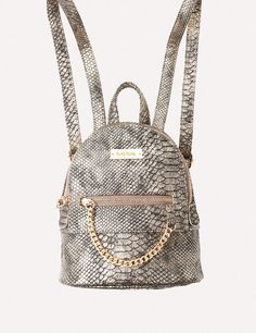 Hit-the-city mini backpack featuring an exterior pocket with fun swag chain  zip pull. Gleaming goldtone hardware channels a luxe vibe. fc0d27e309