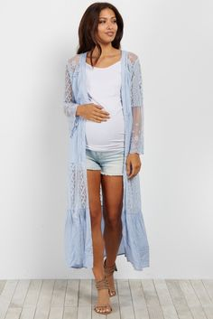 This boho chic maternity kimono will take your outfit to the next level. Beautiful crochet detailing, a flowy long line silhouette, and trendy bell sleeves give this kimono a must-have look. Style this pretty little number with a basic top and your favorite maternity jeans for a complete look.