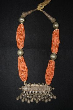 "Exceptional Yemeni necklace; silver and 19 strands of small red coral beads with a central cylindrical amulet tube called ""Hirz"" with hanging dangles measuring 13 cm. 19° to early 20° century. Provenance: Belgian private collection. Ref.: ""Ethnic Jewellry from Africa, Asia and the Pacific"",The René van der Star Collection, The Pepin Press, page 70 - 71 Price: on request. For more information, please email  didiergregoire03@gmail.com"