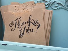 brown paper bag with border punch on the top & stamped message for favors - simple & affordable!
