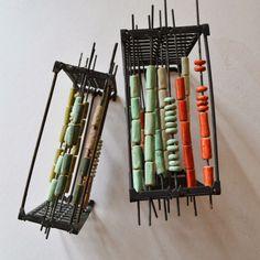 Glazed ceramic beads on their racks www.aalicia.bigcartel.com