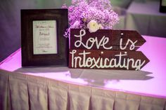 love is intoxicating. Great sign for right by the bar