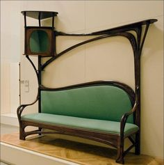 Hector Guimard. Sofa for a smoking room, 1897. I can totally see Neko in the round corner part.