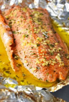 Simple steelhead trout recipe baked in foil with garlic, lemon, butter, and fresh herbs. Garlic Butter Steelhead Trout in Foil - Garlic Butter Steelhead Trout in Foil Recipe Steelhead Trout Recipe Baked, Grilled Trout Recipes, Lake Trout Recipes, Baked Trout, Baked Fish, Whole Trout Recipes, Rainbow Trout Recipe Baked, Catfish Recipes, Fish Dishes