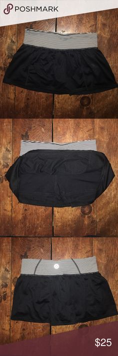AEO Black Tennis Skirt with Spandex Black skirt with black and white striped waistband. Built in Spandex shorts. Measures approx 13 inches across the waist flat American Eagle Outfitters Skirts Mini