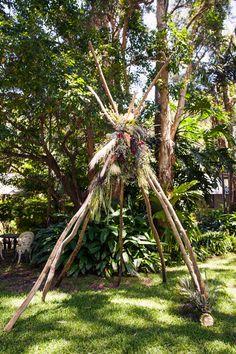 Anna + Kris ceremony backdrop driftwood teepee boho wedding native flowers protea