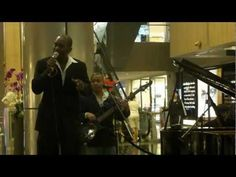 "Martin Elias Reyes (vocals), Milton Villarreal (piano) and Miguel de Avila (bass) performing ""Tu Amor Me Hace Bien"" (Your Love Makes Me Feel Good) at Paragon Shopping Centre"