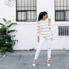 Go monochromatic in a striped sweater with matching jeans and heels
