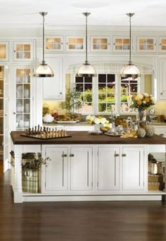 a kitchen with all the elements that define transitional styleshaker style doors with contemporary center island lighting