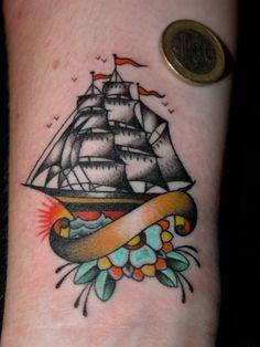 Little ship tattoo by Dan Sinnes.