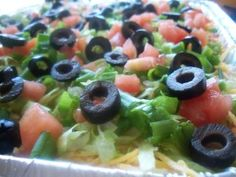 Easy Taco Dip. Photo by *Parsley*  I would like to add some cooked ground beef to this and some fresh salsa.. Sour cream, avacados.. Basically your 7 layer dip.. but add like 9-10 layers,, Mmm