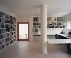 Contemporary Home Office Design in Trendiest Ways: Amazing Comfortable Large Contemporary Office Interior Design With Pillar In The Center At Stylish Contemporary Workspace Also Wall Unit Bookcase And Archives Collections With Pictures Frame ~ boholmain.com Home Office Design Inspiration