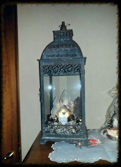 Lanterna in ferro con paesaggio tonalita' narrone