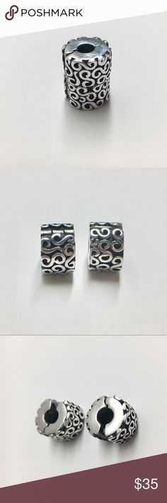 Buy 1, Get 1 FREE Sterling Pandora Serpentine Clip Serpentine S clip is a pretty way to accent your charms and keep them in place.  Swirl design in Sterling Silver. Price is firm.  Style #790338 Pandora Jewelry Bracelets