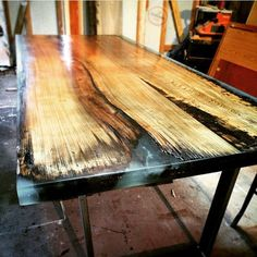 Cypress slab with epoxy in the grooves, steel legs. barndogmill@gmail.com