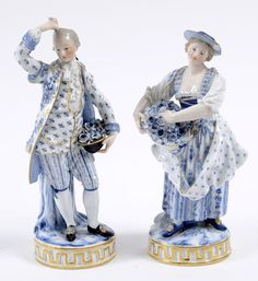 A pair of late 19th century Meissen figures, of a lady and gentleman holding baskets of flowers