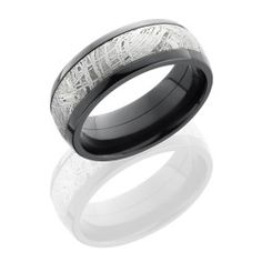 Zirconium Meteroite Ring  - Zirconium 8mm Domed Band with 5mm Meteorite inlay   Your Meteorite ring was made entirely in the United States using authentic Gibeon Meteorite from Namibia, Africa. Gibeon meteorite is well known for its striking Widmanstatten lines. These lines are formed over millions of years to create a crystalline structure exclusive to meteorite, making your ring unique in its pattern and a one-of-a-kind piece of art. This ring can be custom made with your choice of 14K…