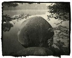 A boulder by a lake  N. KBAYASHI