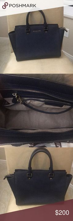Large Navy Blue Selma Handbag! Used only a handful of times, I've had this bag a little over three years. It's in great condition! Michael Kors Bags