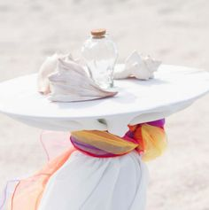 Tropical inspired colors for the unity sand ceremony table