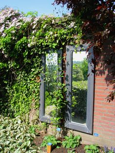 Garden Mirror on Brick Wall. Love this in the garden.