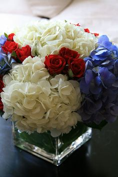 White and blue hydrangeas and mini roses can be used as a patriotic table setting :: 4th of July Centerpiece :: red, white, blue