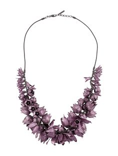 """BURBERRY TULIP NECKLACE $725.00  PRODUCT DETAILSRETURN POLICY Lavender Burberry metal tulip black cord necklace with lobster claw closure. Estimated Retail: $1995.00 Condition: Excellent. Measurements: Chain Length 34"""", Ornament Width 1.75"""", Ornament Length 1.5"""" Designer: Burberry Item # BUR22608"""