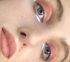 peach eyes and lips, white eyeliner under eye