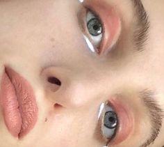 peach eyes and lips, white eyeliner under eye