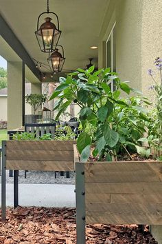 Rustic Elevated Planter With Self-Watering Baseboards via The Mellionaire House. #gardening #smallgarden #rustic #elevated #planter #selfcontained #wateringsystem