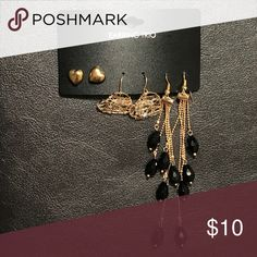 Earrings 3 piece set of earrings with 1 pair of gold heart shaped ear studs, medium sized heart shaped crystal embedded earrings and a 4 stranded gold earrings with black crystals. Jewelry Earrings