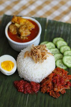 Nasi Lemak (Rice in coconut milk) with Chicken Curry - Malaysian Breakfast