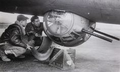Photo: Weaponsmith and shooter at the bottom turret of the US B-17 bomber