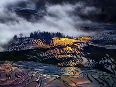 rainbow's Terraces - Shooting early morning in my workshop in Yuanyang Rice fields terraces , I have got  an amazing combination of fog , strong wind  and light . the light ray was spraying al around the terraces  and  my phase one sensor 16 bit was able  to capture this colorful image .
