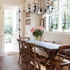 """This airy kitchen was designed to feel like a """"California farmhouse,"""" embodying casual sophistication. Although the cottage is surrounded by the hustle and bustle of Los Angeles, this tranquil space is an oasis of comfort and style."""