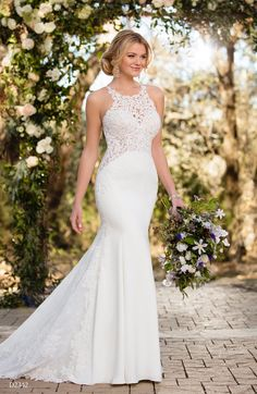 Nice Essense of Australia Lace and crepe e together in a sleek column silhouette on this Essense of Australia gown with long sheer lace side cutouts and