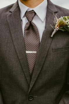 Charcoal gray suit, striped tie, debonair groom // Candace Nicole Photography