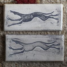 "Sarah Snavely ~ Featuring my running Greyhound Whippet design incised into the tile's surface. It measures approximately 2"" x 4"" x 3/8"" (size varies slightly due to its handmade nature). Notched in the back for hanging.This tile is handmade of earthenware clay by me, Sarah Regan Snavely, in my North Dakota studio. Artist signed."
